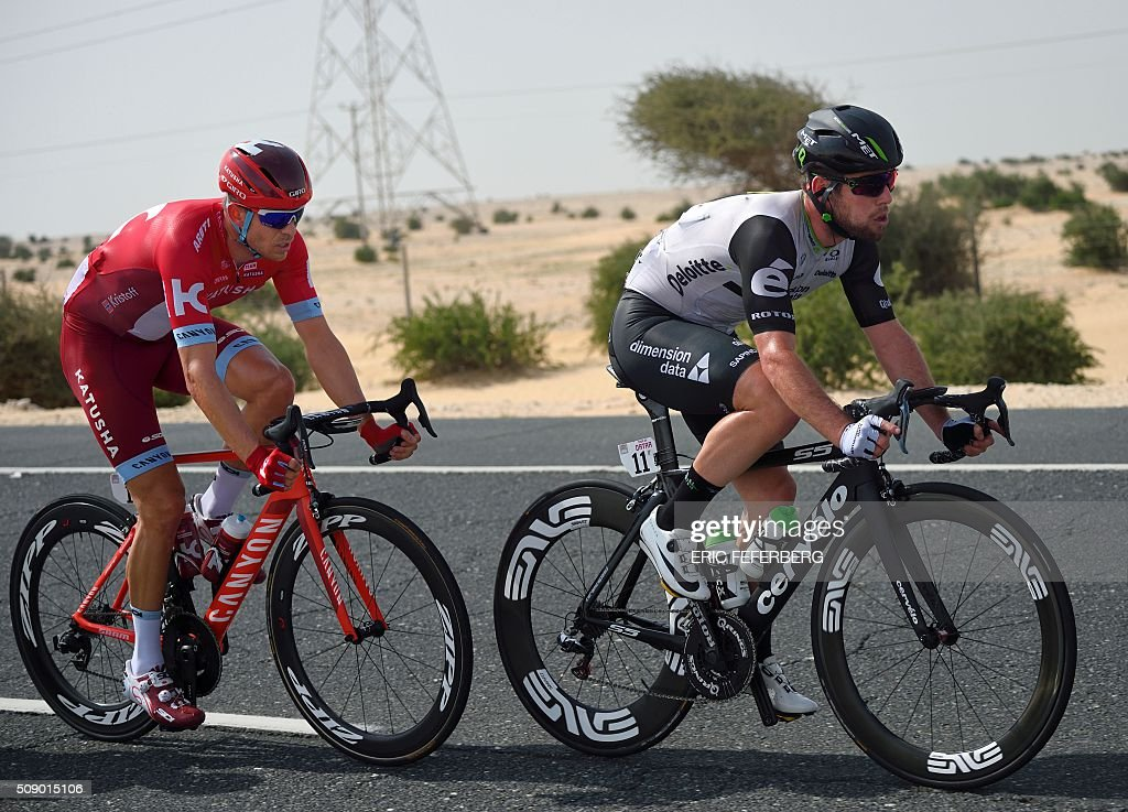 Dimension Data team leader, Britain's Mark Cavendish (R) rides ahead of Norway's Katusha team leader Alexander Kristoff during the first stage of the 2016 Tour of Qatar, between Dukhan and Al Khor Corniche on February 8, 2016. Cavendish, the former world road race champion, took the gold jersey and covered the 175 kilometres from Dukhan to the Al Khor corniche, north of the capital Doha, in 3hrs 28.31secs, eight seconds in front of Modolo and 11 seconds ahead of Guardini. / AFP / ERIC FEFERBERG