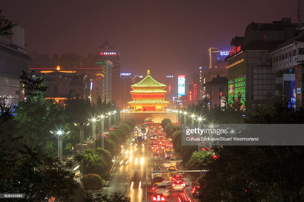 Diminishing perspective of road to Xian bell tower illuminated at night, China