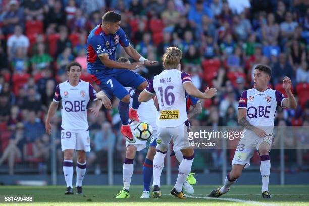 Dimiri Petratos of the Jets attempts to control the ball during the round two ALeague match between the Newcastle Jets and the Perth Glory at...