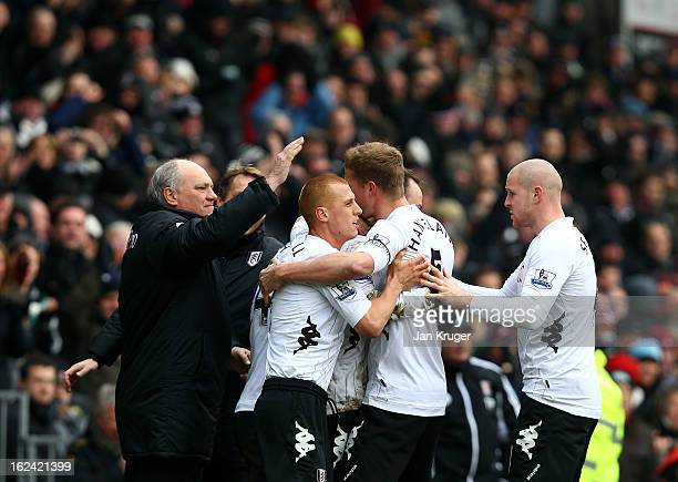 Dimitar Berbatov of Fulham celebrates his goal with Martin Jol Manager of Fulham and team mates during the Barclays Premier League match between...