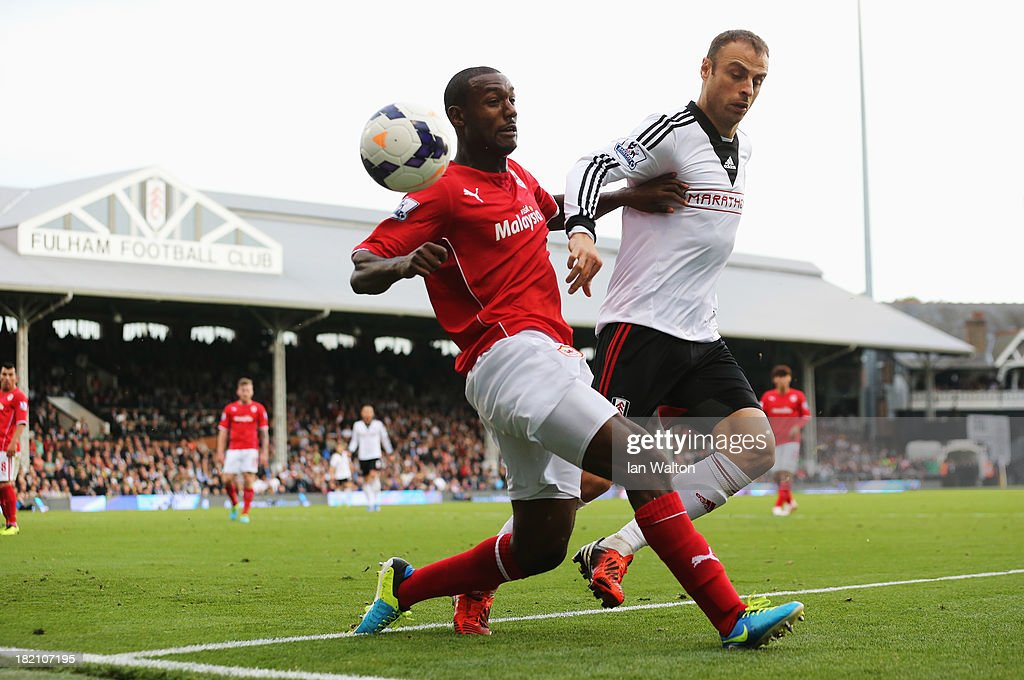 <a gi-track='captionPersonalityLinkClicked' href=/galleries/search?phrase=Dimitar+Berbatov&family=editorial&specificpeople=216379 ng-click='$event.stopPropagation()'>Dimitar Berbatov</a> of Fulham is challenged by Kevin Theophile Catherine of Cardiff City during the Barclays Premier League match between Fulham and Cardiff City at Craven Cottage on September 28, 2013 in London, England.