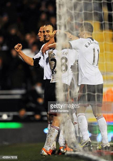 Dimitar Berbatov of Fulham is congratulated by teammates after scoring his team's second goal during the Barclays Premier League match between Fulham...