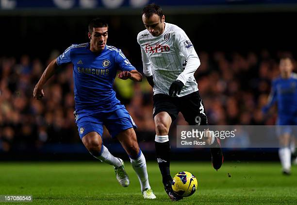 Dimitar Berbatov of Fulham is pursued by Oriol Romeu of Chelsea during the Barclays Premier League match between Chelsea and Fulham at Stamford...