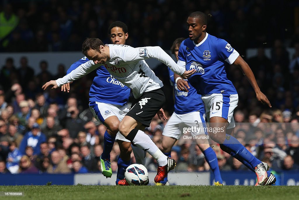 <a gi-track='captionPersonalityLinkClicked' href=/galleries/search?phrase=Dimitar+Berbatov&family=editorial&specificpeople=216379 ng-click='$event.stopPropagation()'>Dimitar Berbatov</a> of Fulham moves away from <a gi-track='captionPersonalityLinkClicked' href=/galleries/search?phrase=Sylvain+Distin&family=editorial&specificpeople=213749 ng-click='$event.stopPropagation()'>Sylvain Distin</a> of Everton during the Barclays Premier League match between Everton and Fulham at Goodison Park on April 27, 2013 in Liverpool, England.