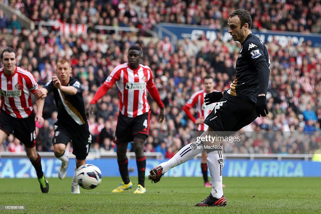 <a gi-track='captionPersonalityLinkClicked' href=/galleries/search?phrase=Dimitar+Berbatov&family=editorial&specificpeople=216379 ng-click='$event.stopPropagation()'>Dimitar Berbatov</a> of Fulham scores from the penalty spot during the Barclays Premier League match between Sunderland and Fulham at the Stadium of Light on March 02, 2013 in Sunderland, England.