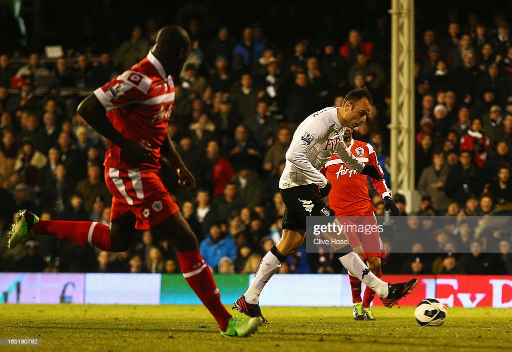 Dimitar Berbatov of Fulham scores his sides second goal during the Barclays Premier League match between Fulham and Queens Park Rangers at Craven Cottage on April 1, 2013 in London, England.