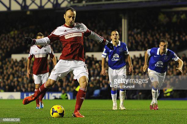 Dimitar Berbatov of Fulham scores his team's first goal from the penalty spot during the Barclays Premier League match between Everton and Fulham at...