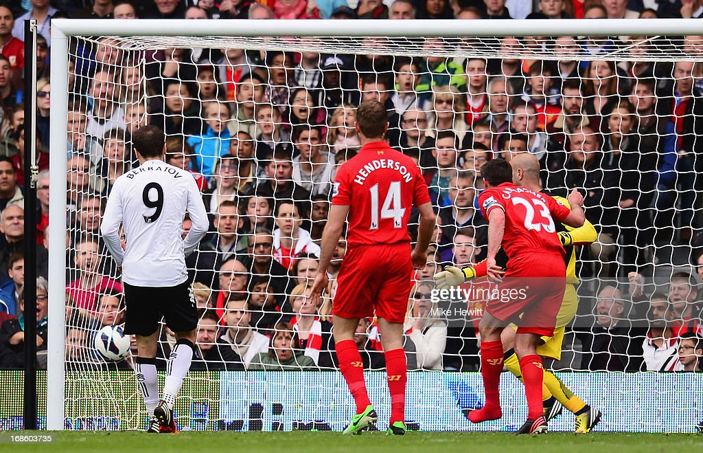 Dimitar Berbatov of Fulham (9) scores their first goal during the Barclays Premier League match between Fulham and Liverpool at Craven Cottage on May 12, 2013 in London, England.