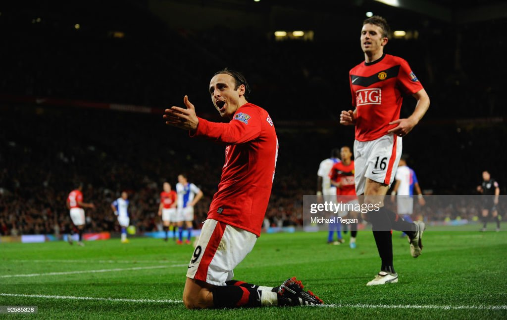 <a gi-track='captionPersonalityLinkClicked' href=/galleries/search?phrase=Dimitar+Berbatov&family=editorial&specificpeople=216379 ng-click='$event.stopPropagation()'>Dimitar Berbatov</a> of Manchester United celebrates scoring the first goal during the Barclays Premier League match between Manchester United and Blackburn Rovers at Old Trafford on October 31, 2009 in Manchester, England.