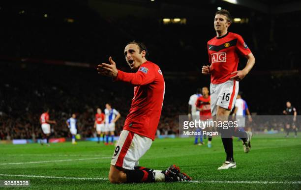 Dimitar Berbatov of Manchester United celebrates scoring the first goal during the Barclays Premier League match between Manchester United and...