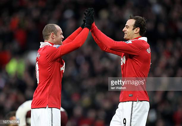 Dimitar Berbatov of Manchester United celebrates scoring the opening goal with team mate Wayne Rooney during the Barclays Premier League match...