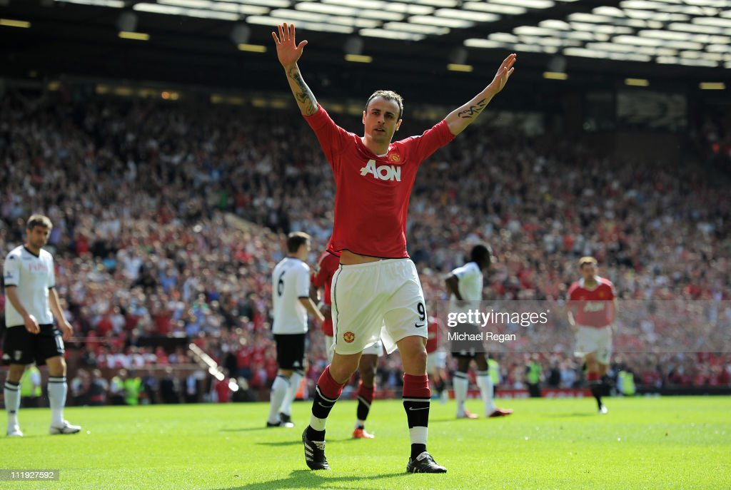 <a gi-track='captionPersonalityLinkClicked' href=/galleries/search?phrase=Dimitar+Berbatov&family=editorial&specificpeople=216379 ng-click='$event.stopPropagation()'>Dimitar Berbatov</a> of Manchester United celebrates scoring the opening goal during the Barclays Premier League match between Manchester United and Fulham at Old Trafford on April 9, 2011 in Manchester, England.