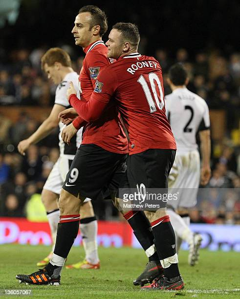 Dimitar Berbatov of Manchester United celebrates scoring their fifth goal during the Barclays Premier League match between Fulham and Manchester...