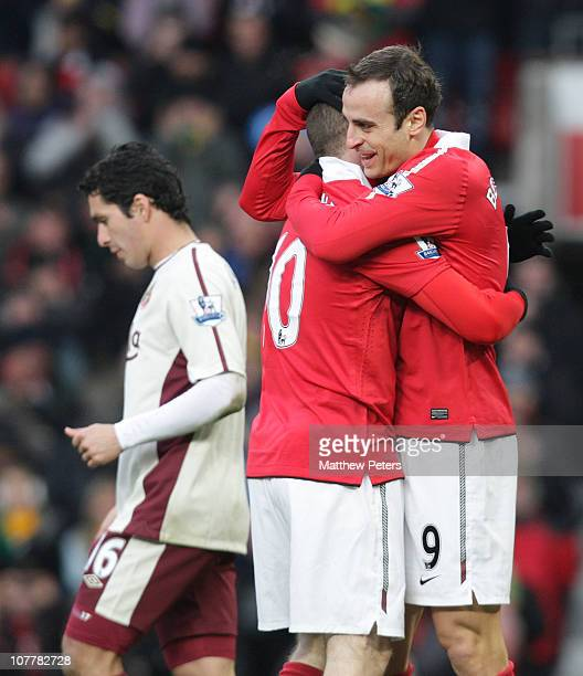 Dimitar Berbatov of Manchester United celebrates scoring their first goal with Wayne Rooney during the Barclays Premier League match between...