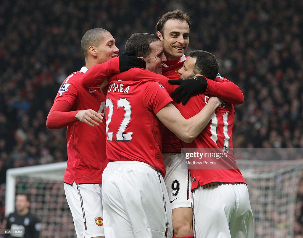 <a gi-track='captionPersonalityLinkClicked' href=/galleries/search?phrase=Dimitar+Berbatov&family=editorial&specificpeople=216379 ng-click='$event.stopPropagation()'>Dimitar Berbatov</a> of Manchester United celebrates scoring their first goal during the Barclays Premier League match between Manchester United and Birmingham City at Old Trafford on January 22, 2011 in Manchester, England.