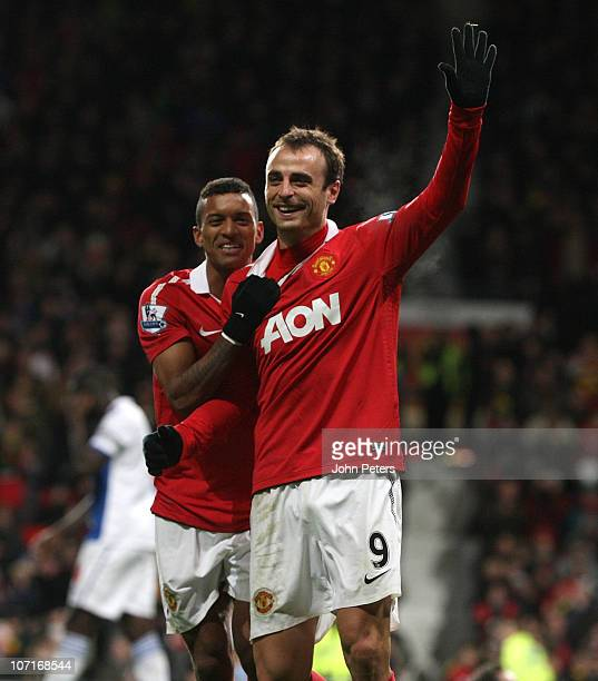 Dimitar Berbatov of Manchester United celebrates scoring their seventh goal during the Barclays Premier League match between Manchester United and...