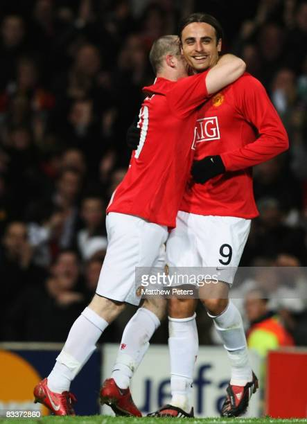 Dimitar Berbatov of Manchester United celebrates scoring their second goal during the UEFA Champions League Group E match between Manchester United...