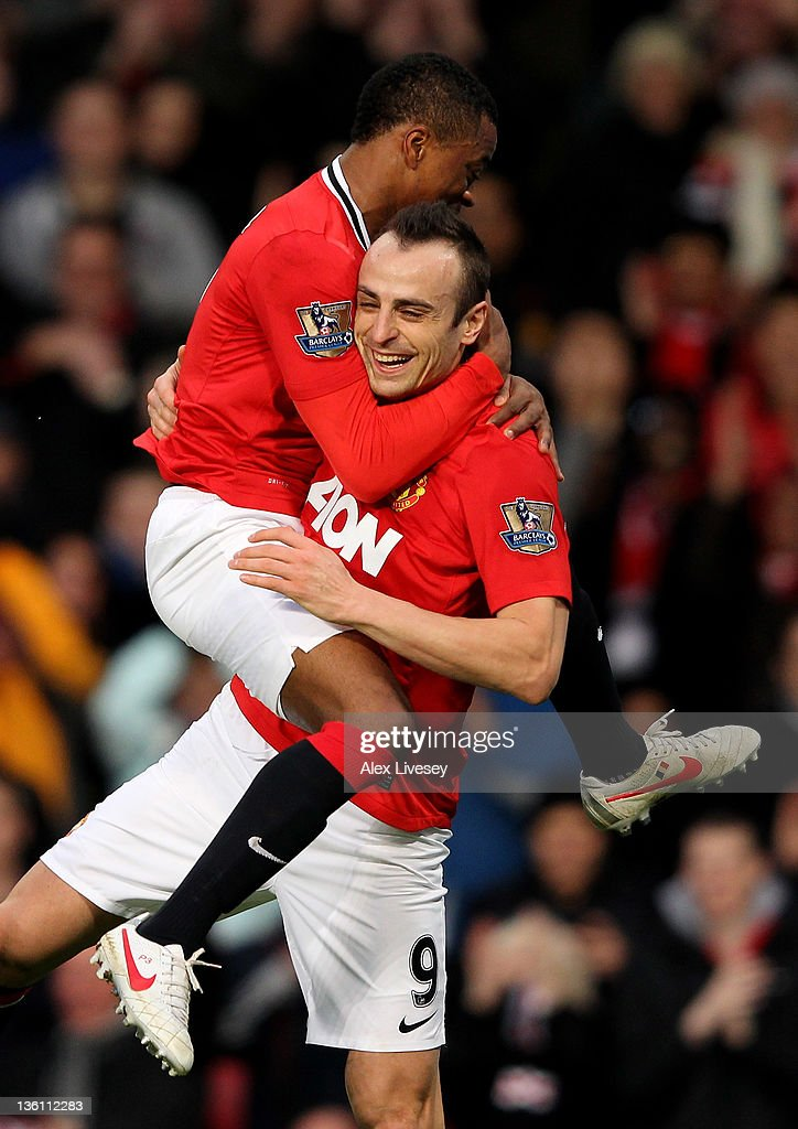 <a gi-track='captionPersonalityLinkClicked' href=/galleries/search?phrase=Dimitar+Berbatov&family=editorial&specificpeople=216379 ng-click='$event.stopPropagation()'>Dimitar Berbatov</a> of Manchester United celebrates scoring with team mate <a gi-track='captionPersonalityLinkClicked' href=/galleries/search?phrase=Patrice+Evra&family=editorial&specificpeople=714865 ng-click='$event.stopPropagation()'>Patrice Evra</a> (L) during the Barclays Premier League match between Manchester United and Wigan Athletic at Old Trafford on December 26, 2011 in Manchester, England.