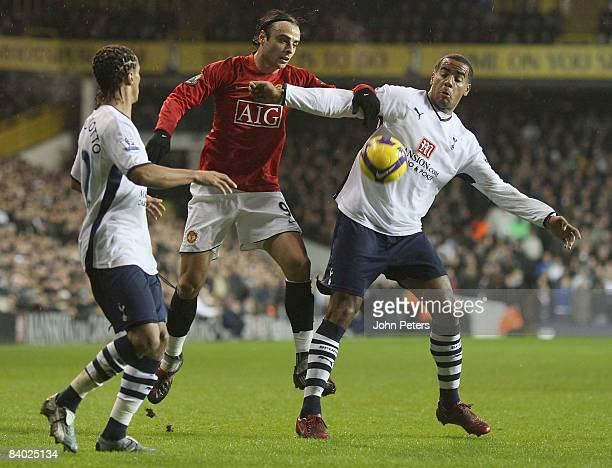 Dimitar Berbatov of Manchester United clashes with Benoit AssouEkotto and Tom Huddlestone of Tottenham Hotspur during the Barclays Premier League...