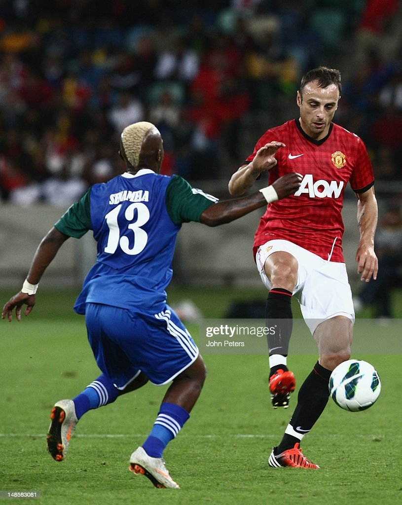Dimitar Berbatov of Manchester United clashes with Bongani Mbele of AmaZulu FC during the pre-season friendly between AmaZulu FC and Manchester United at Moses Mabhida Stadium on July 18, 2012 in Durban, South Africa.