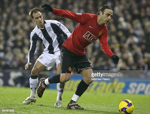Dimitar Berbatov of Manchester United clashes with Borja Valero of West Bromwich Albion during the Barclays Premier League match between West...