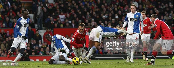 Dimitar Berbatov of Manchester United clashes with Christopher Samba and Michel Salgado of Blackburn Rovers during the Barclays Premier League match...