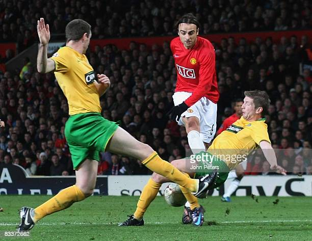 Dimitar Berbatov of Manchester United clashes with Mark Wilson of Celtic during the UEFA Champions League Group E match between Manchester United and...