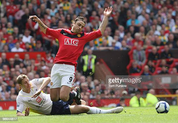 Dimitar Berbatov of Manchester United clashes with Michael Dawson of Tottenham Hotspur during the Barclays Premier League match between Manchester...