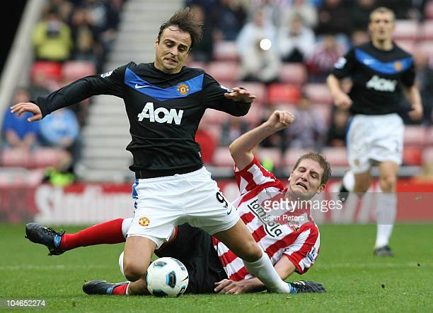 Dimitar Berbatov of Manchester United clashes with Michael Turner of Sunderland during the Barclays Premier League match between Sunderland and...