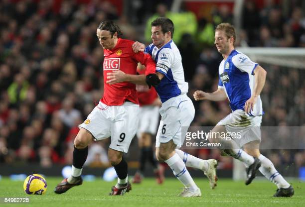 Dimitar Berbatov of Manchester United clashes with Ryan Nelsen of Blackburn Rovers during the Barclays Premier League match between Manchester United...