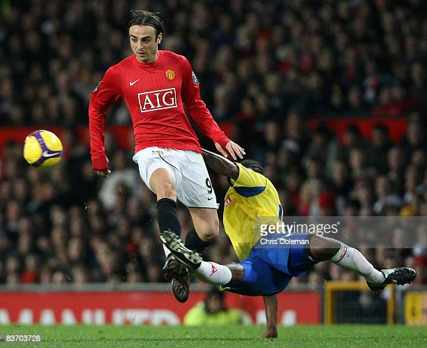 Dimitar Berbatov of Manchester United clashes with Salif Diao of Stoke City during the Barclays Premier League match between Manchester United and...