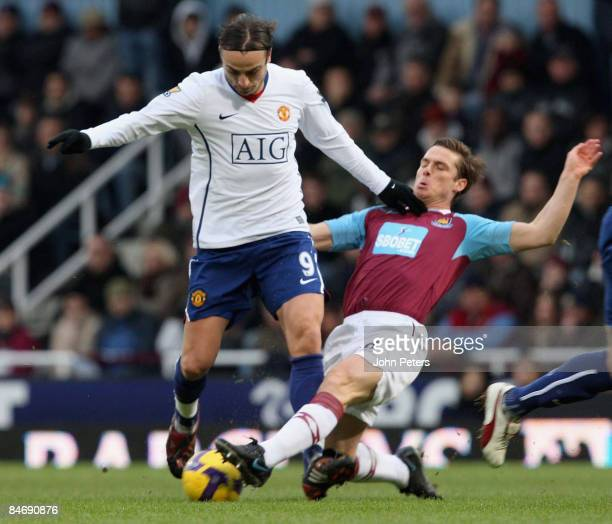 Dimitar Berbatov of Manchester United clashes with Scott Parker of West Ham United during the Barclays Premier League match between West Ham United...
