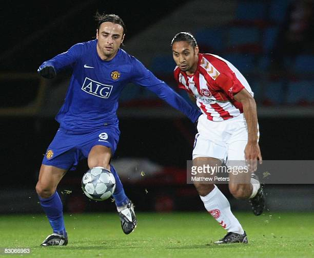 Dimitar Berbatov of Manchester United clashes with Steve Olfers of Aalborg BK during the UEFA Champions League Group E match between Aalborg BK and...