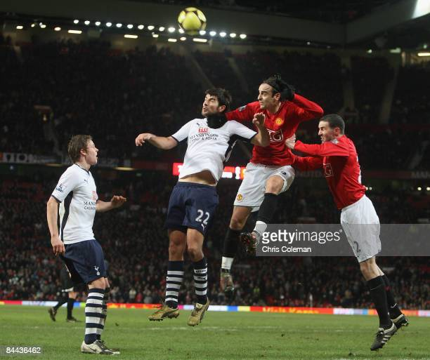 Dimitar Berbatov of Manchester United clashes with Vedran Corluka of Tottenham Hotspur during the FA Cup sponsored by eon Fourth Round match between...