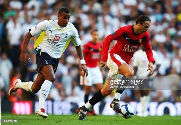 Dimitar Berbatov of Manchester United is pursued by Tom Huddlestone of Tottenham during the Barclays Premier League match between Tottenham Hotspur...