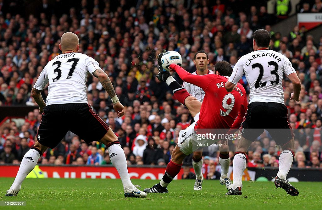 <a gi-track='captionPersonalityLinkClicked' href=/galleries/search?phrase=Dimitar+Berbatov&family=editorial&specificpeople=216379 ng-click='$event.stopPropagation()'>Dimitar Berbatov</a> of Manchester United scores his team's second goal during the Barclays Premier League match between Manchester United and Liverpool at Old Trafford on September 19, 2010 in Manchester, England.
