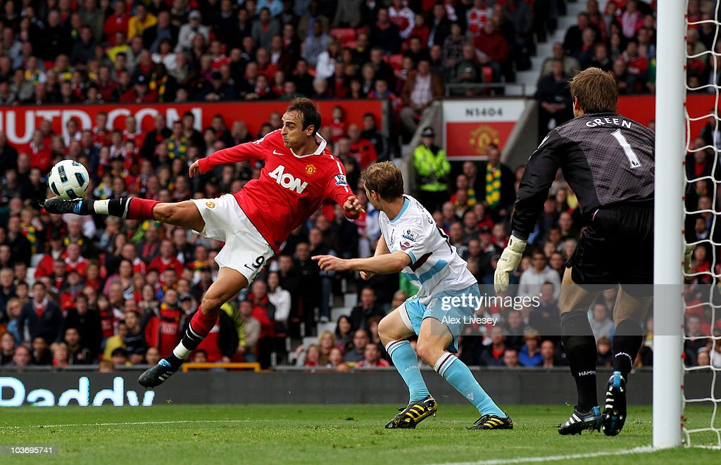 <a gi-track='captionPersonalityLinkClicked' href=/galleries/search?phrase=Dimitar+Berbatov&family=editorial&specificpeople=216379 ng-click='$event.stopPropagation()'>Dimitar Berbatov</a> of Manchester United scores his team's third goal during the Barclays Premier League match between Manchester United and West Ham United at Old Trafford on August 28, 2010 in Manchester, England.