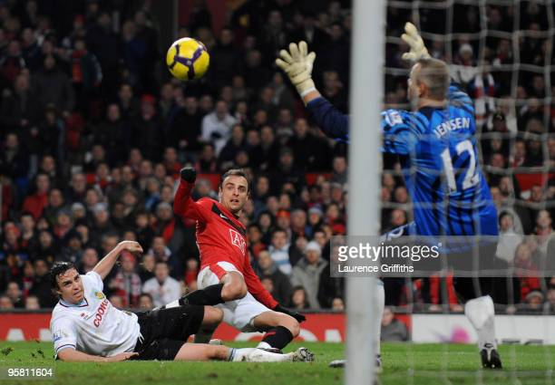 Dimitar Berbatov of Manchester United scores the first goal past Brian Jensen of Burnley during the Barclays Premier League Match between Manchester...