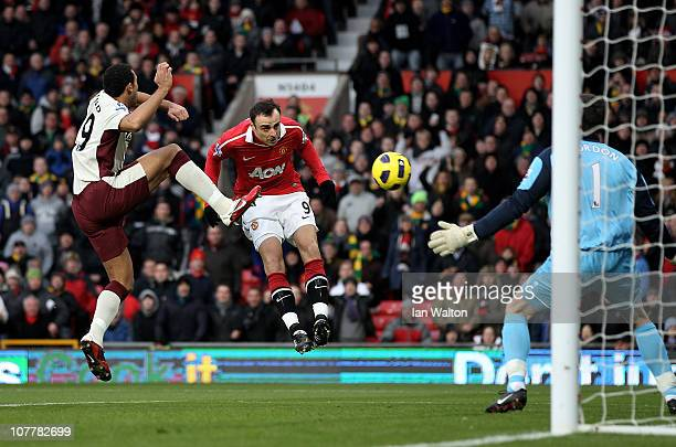 Dimitar Berbatov of Manchester United scores the opening goal during the Barclays Premier League match between Manchester United and Sunderland at...