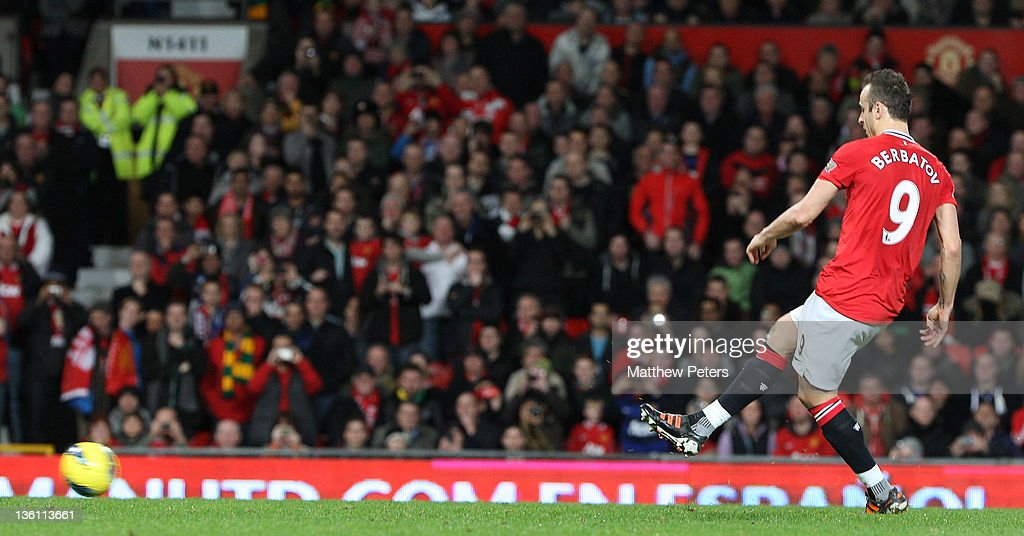 <a gi-track='captionPersonalityLinkClicked' href=/galleries/search?phrase=Dimitar+Berbatov&family=editorial&specificpeople=216379 ng-click='$event.stopPropagation()'>Dimitar Berbatov</a> of Manchester United scores their fifth goal during the Barclays Premier League match between Manchester United and Wigan Athletic at Old Trafford on December 26, 2011 in Manchester, England.
