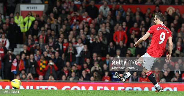 Dimitar Berbatov of Manchester United scores their fifth goal during the Barclays Premier League match between Manchester United and Wigan Athletic...