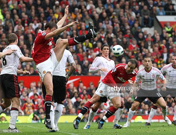 Dimitar Berbatov of Manchester United scores their first goal during the Barclays Premier League match between Manchester United and Liverpool at Old...