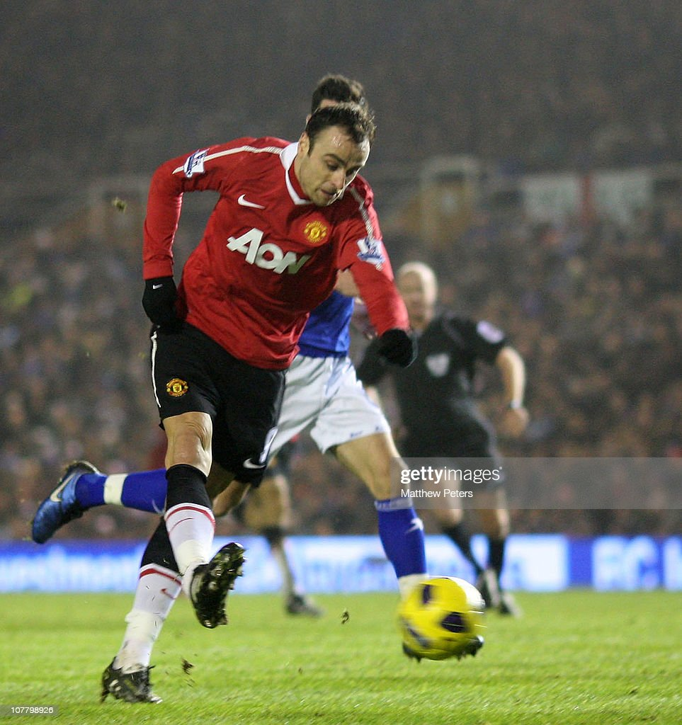 <a gi-track='captionPersonalityLinkClicked' href=/galleries/search?phrase=Dimitar+Berbatov&family=editorial&specificpeople=216379 ng-click='$event.stopPropagation()'>Dimitar Berbatov</a> of Manchester United scores their first goal during the Barclays Premier League match between Birmingham City and Manchester United at St Andrews on December 28, 2010 in Birmingham, England.