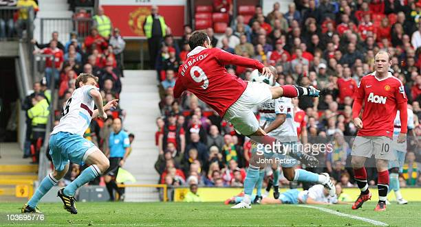 Dimitar Berbatov of Manchester United scores their third goal during the Barclays Premier League match between Manchester United and West Ham United...