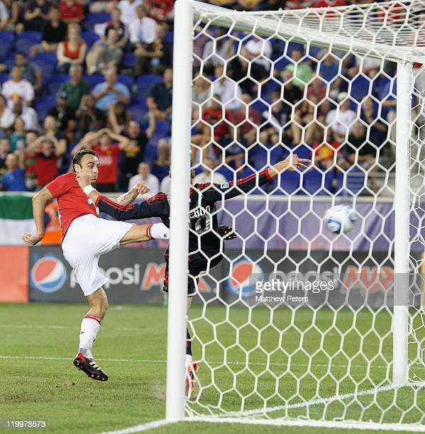 Dimitar Berbatov of Manchester United scores their third goal during the MLS All Star match between MLS All Stars and Manchester United at Red Bull...