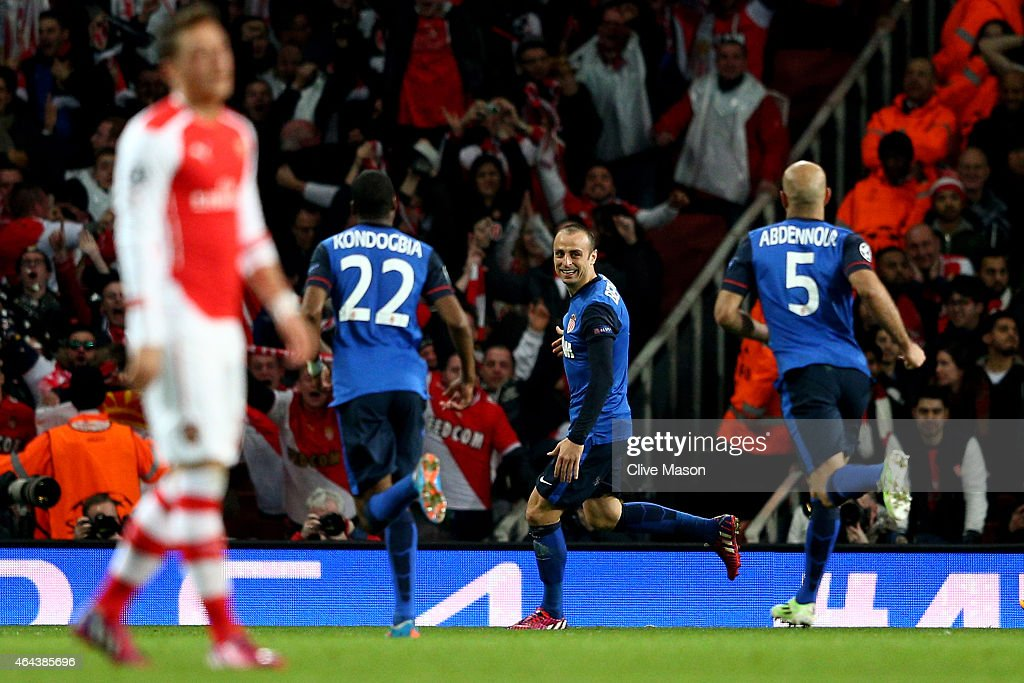 Dimitar Berbatov (2nd R) of Monaco celebrates with teammates after scorin his team's second goal during the UEFA Champions League round of 16, first leg match between Arsenal and Monaco at The Emirates Stadium on February 25, 2015 in London, United Kingdom.