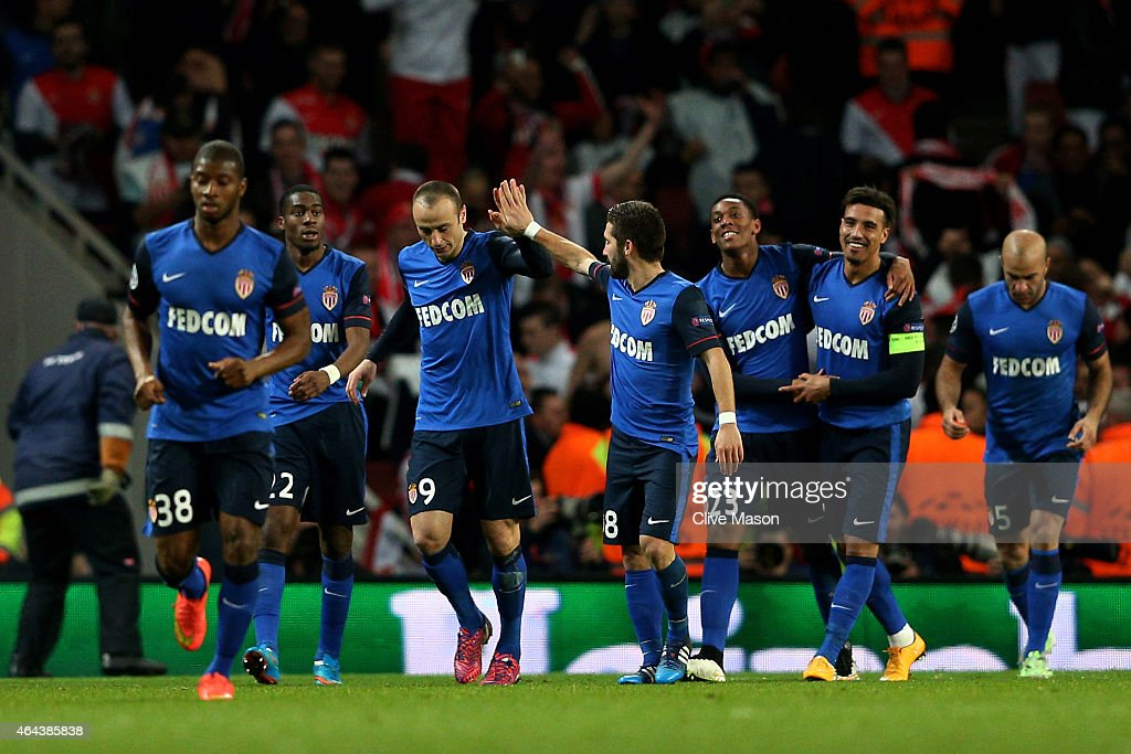 Dimitar Berbatov of Monaco celebrates with teammates after scorin his team's second goal during the UEFA Champions League round of 16 first leg match...
