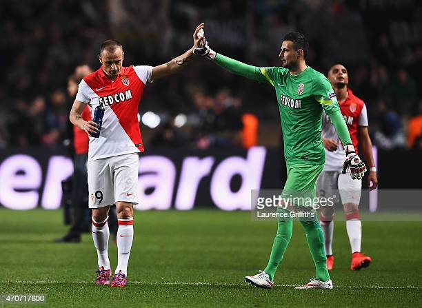 Dimitar Berbatov of Monaco is consoled by goalkeeper Danijel Subasic of Monaco after the UEFA Champions League quarterfinal second leg match between...