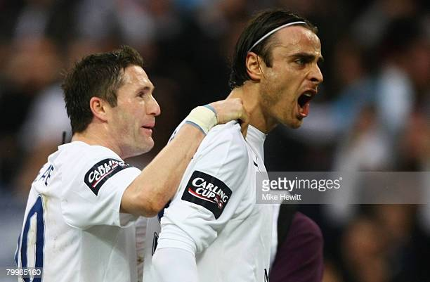 Dimitar Berbatov of Tottenham Hotspur celebrates with Robbie Keane as he scores their first goal from the penalty spot during the Carling Cup Final...