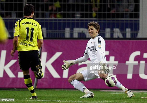 Dimitar Rangelov of Dortmund scores his team's third goal against Rene Adler of Leverkusen during the Bundesliga match between Borussia Dortmund and...